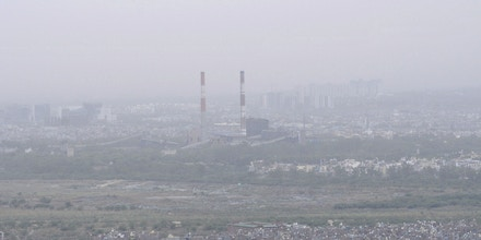 Air pollution led to low visibility throughout India's National Capital Region, including in the city of Noida on June 11, 2019.