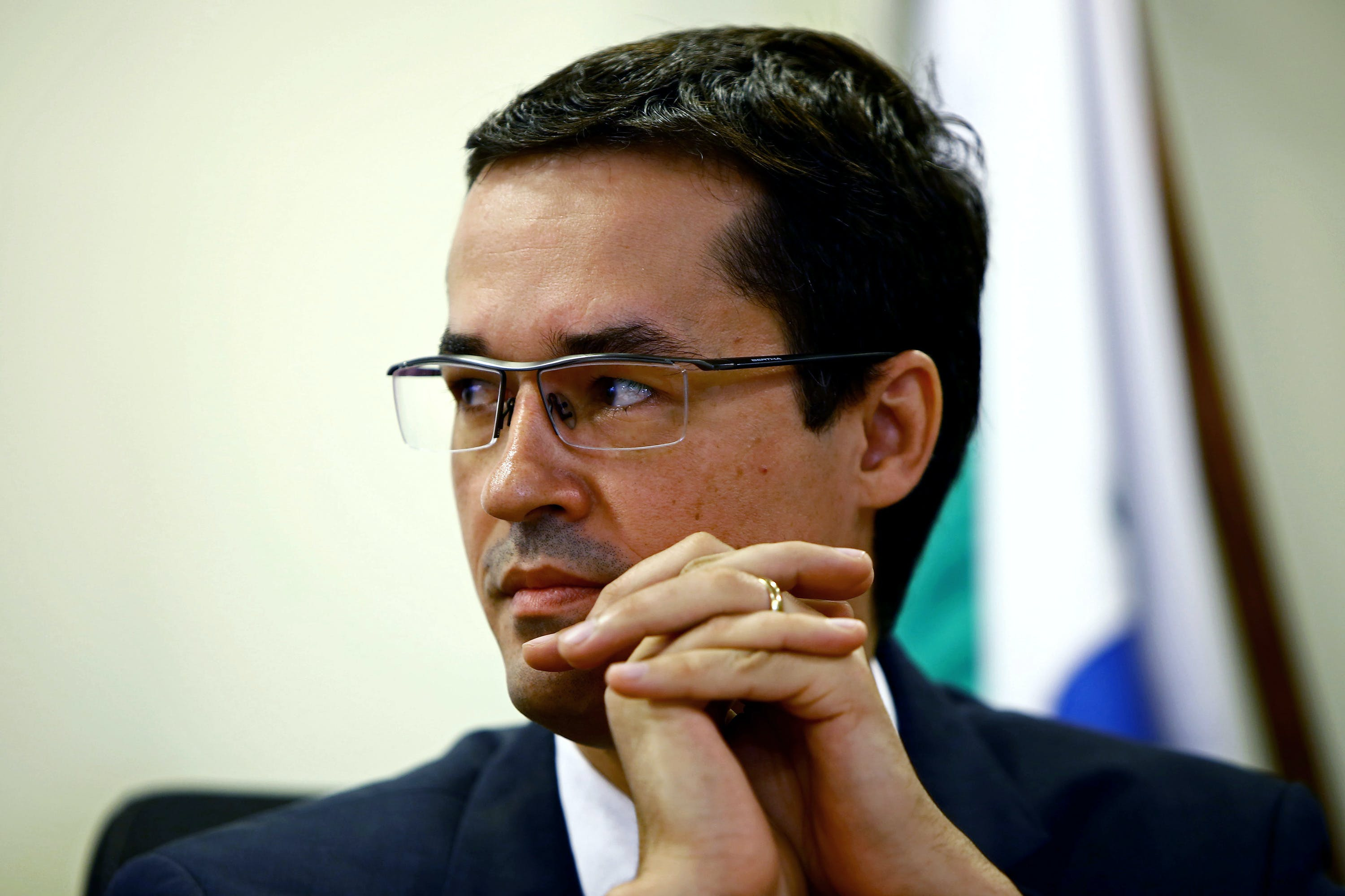 Brazilian Federal Attorney Deltan Dallagnol listens, during the ceremony for the return of resources to Petrobras, which were recovered through cooperation and leniency agreements in connection with Lava Jato operation, in Curitiba, Brazil on December 07, 2017. Petrobras received 654 million reais (200 million dollars) from legal agreements related to Lava Jato operation, the largest corruption investigation in Brazil's history, the state-owned company reported. / AFP PHOTO / Heuler Andrey (Photo credit should read HEULER ANDREY/AFP/Getty Images)