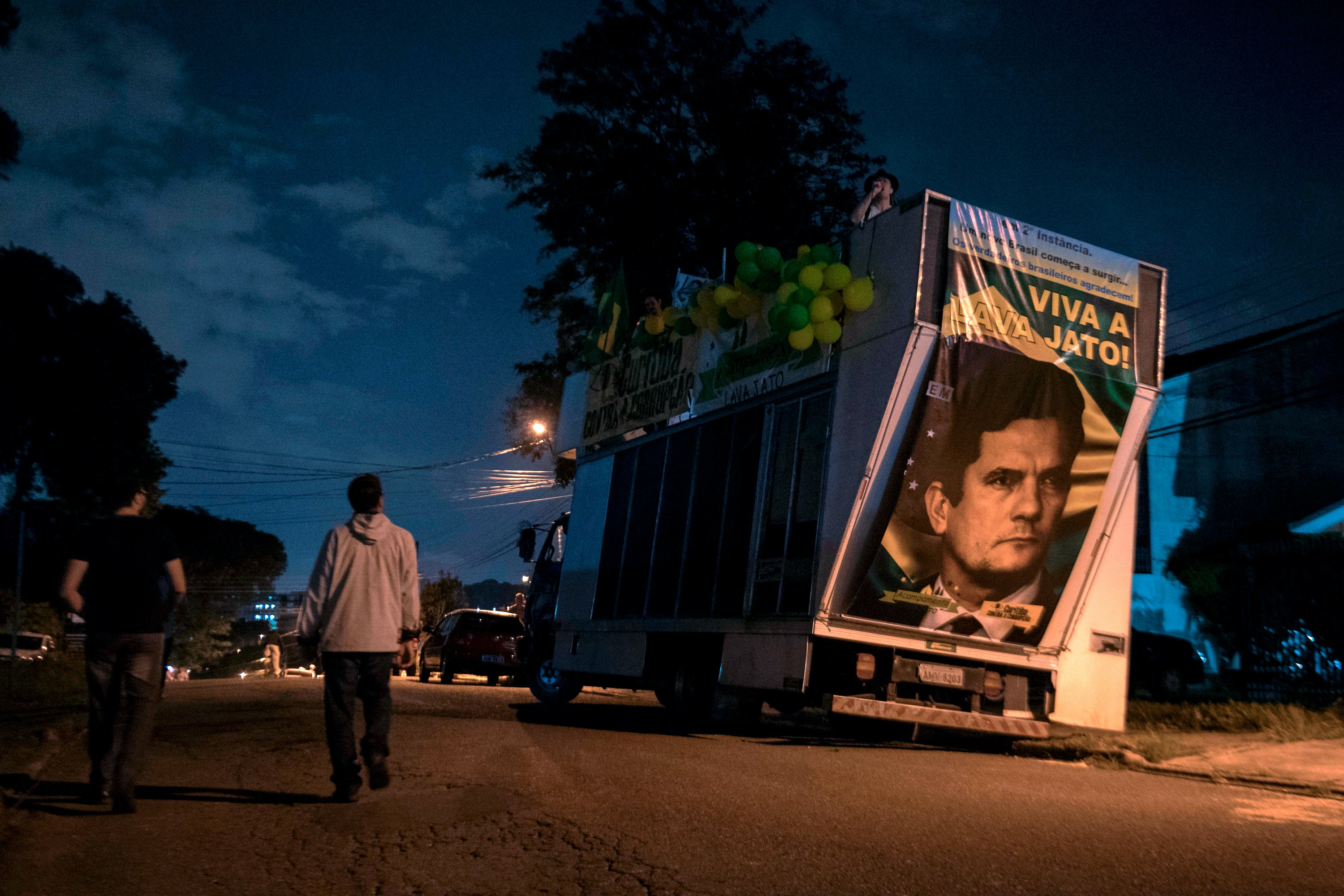 "View of a truck with a portrait of Brazilian judge Sergio Moro reading ""Long live Lava Jato"", referring to an anti-corrption operation, during a protest against Brazilian former president (2003-2011) Luiz Inacio Lula Da Silva outside the Federal Police headquarters, where he is awaited to start his 12-year prison sentence in Curitiba, Parana, Brazil. Lula da Silva, the controversial frontrunner in Brazil's October presidential election, remained defiantly holed up Friday as a deadline for him to surrender and start a 12-year prison sentence for corruption loomed."