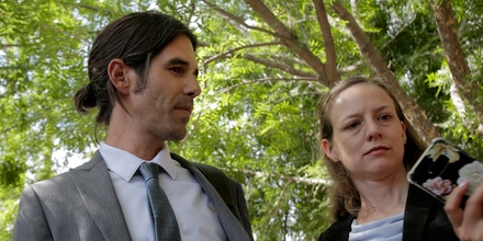 Scott Warren, left, accompanied by one of his defense lawyers, Amy Knight, speaks with press outside federal court in Tucson, Ariz., on June 11, 2019.