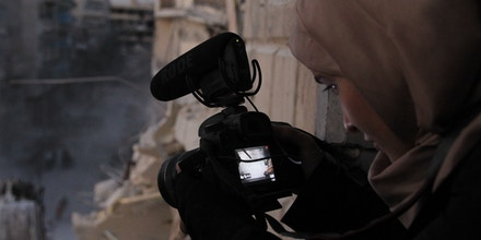 Waad al-Kateab films the ruins of a building destroyed by bombing in besieged east Aleppo, Syria, in Oct. 2016.