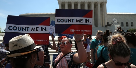 WASHINGTON, DC - JUNE 27: People gather in in front of the U.S. Supreme Court as decisions are handed down on June 27, 2019 in Washington, DC. The high court blocked a citizenship question from being added to the 2020 census for now, and in another decision ruled that the Constitution does not bar partisan gerrymandering. (Photo by Mark Wilson/Getty Images)