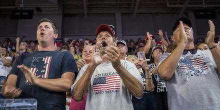GREENVILLE, NC - JULY 17: Supporters of President Donald Trump applaud during a Keep America Great rally on July 17, 2019 in Greenville, North Carolina. Trump is speaking in North Carolina only hours after The House of Representatives voted down an effort from a Texas Democrat to impeach the President. (Photo by Zach Gibson/Getty Images)