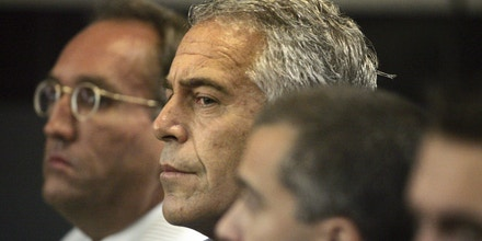 FILE- In this July 30, 2008 file photo, Jeffrey Epstein appears in court in West Palm Beach, Fla. U.S. District Judge Kenneth Marra ruled Thursday, Feb. 21, 2019, that federal prosecutors violated the rights of victims by secretly reaching a non-prosecution agreement with Epstein, a wealthy financier accused of sexually abusing dozens of underage girls. (AP Photo/Palm Beach Post, Uma Sanghvi, File)