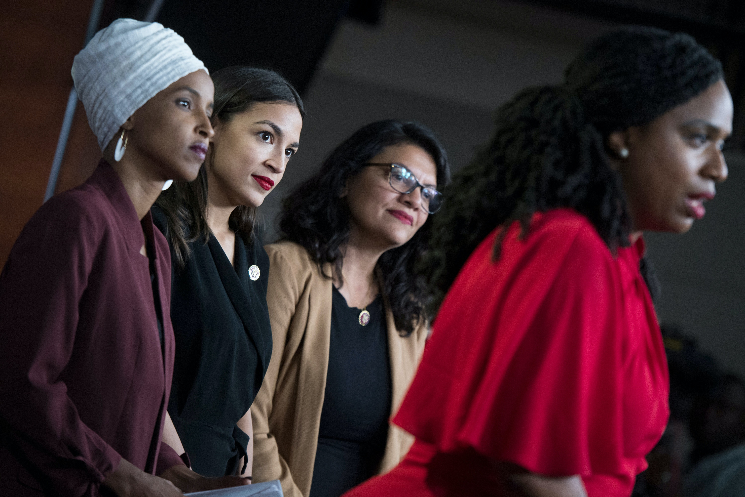 UNITED STATES - JULY 15: From left, Reps. Ilhan Omar, D-Minn., Alexandria Ocasio-Cortez, D-N.Y., Rashida Tlaib, D-Mich., and Ayanna Pressley, D-Mass., conduct a news conference in the Capitol Visitor Center responding to negative comments by President Trump that were directed at the freshman House Democrats on Monday, July 15, 2019. (Photo By Tom Williams/CQ Roll Call via AP Images)