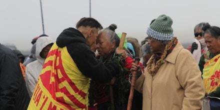 Kumu hula Bradford Ikemanu Lum, left, greets with kupuna Noe Noe Wong-Wilson during the seventh day of protests against the TMT telescope on Monday, July 22, 2019, at the base of Mauna Kea on Hawaii Island. (Jamm Aquino/Honolulu Star-Advertiser via AP)