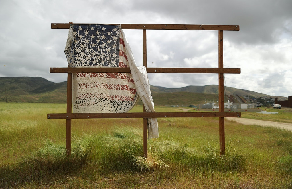 "OTAY MESA, CALIFORNIA - APRIL 03: An old billboard which displayed a U.S. flag stands on the U.S. side of the U.S.-Mexico border on April 3, 2019 in Otay Mesa, California. U.S President Trump told reporters last week ""there's a very good likelihood"" that he will close the U.S. Southern border this week.  (Photo by Mario Tama/Getty Images)"