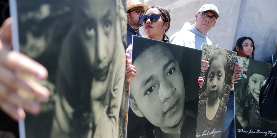CIUDAD JUAREZ, MEXICO - JUNE 27: Activists hold photos of migrant children who died trying to cross the U.S.-Mexico border on June 27, 2019, in Ciudad Juarez, Mexico. El Paso Bishop Mark Seitz and clergy from the Diocese of Ciudad Juarez held a prayer with migrants who were recently returned to Ciudad Juarez from El Paso because of the controversial 'Remain in Mexico' policy. (Photo by Mario Tama/Getty Images)