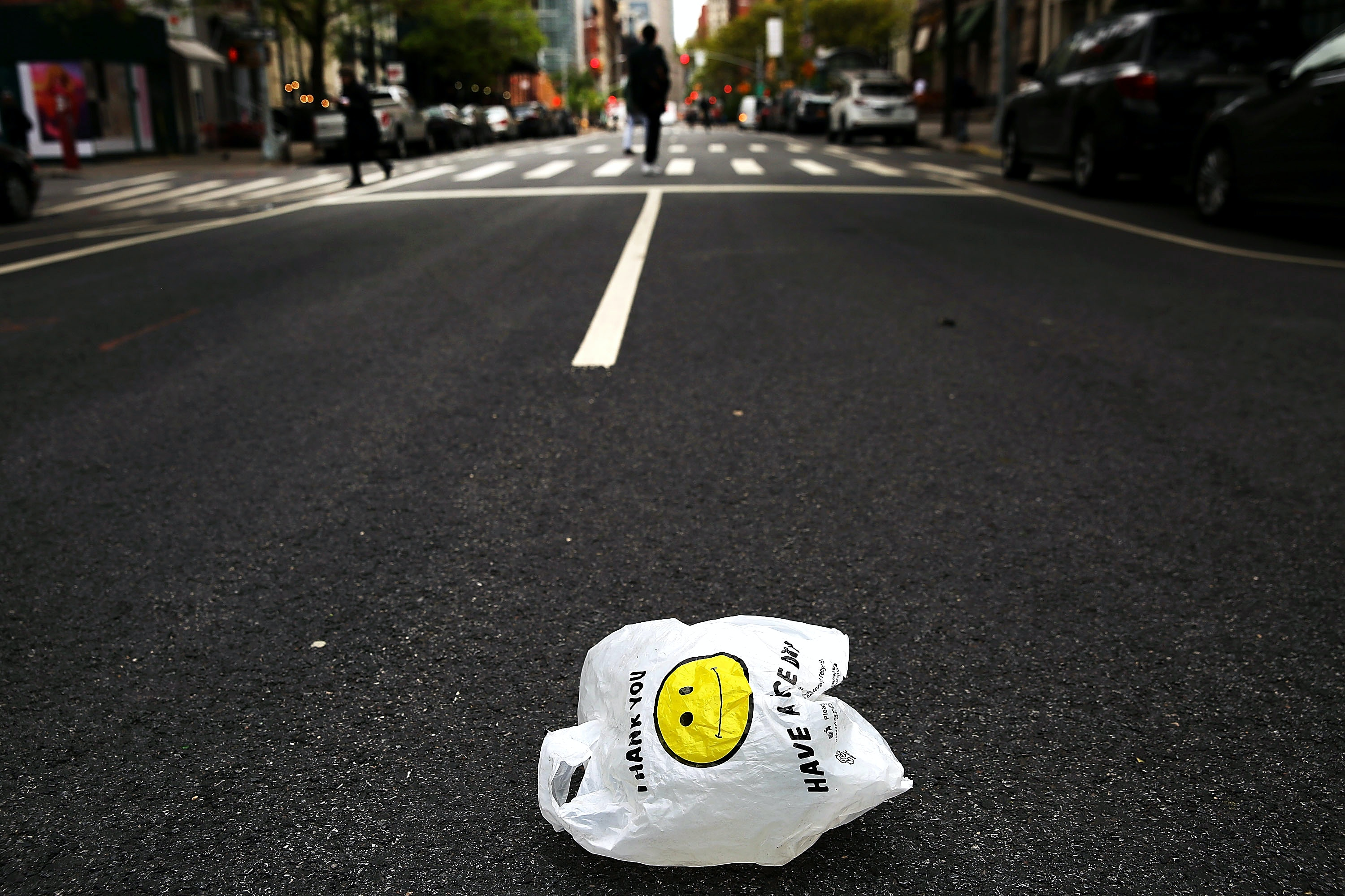 NEW YORK, NY - MAY 05: A plastic bag sits in a Manhattan street on May 05, 2016 in New York City.New York's City Council is scheduled to vote Thursday on a bill that would require most stores to charge five cents per bag in an effort to cut down on plastic waste. New York's sanitation department estimates that every year 10 billion bags are thrown in the trash. (Photo by Spencer Platt/Getty Images)