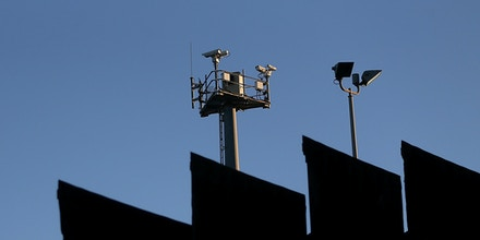 TIJUANA, MEXICO - JANUARY 27:  Surveillance cameras stand above the US-Mexican border fence at Playas de Tijuana on January 27, 2017 in Tijuana, Mexico. U.S. President Donald Trump announced a proposal to impose a 20 percent tax on all imported goods from Mexico to pay for the border wall between the United States and Mexico. Mexican President Enrique Pena Nieto canceled a planned meeting with President Trump over who would pay for Trump's campaign promise to build a border wall.  (Photo by Justin Sullivan/Getty Images)