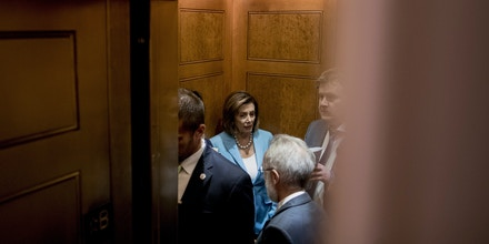 House Speaker Nancy Pelosi of Calif. departs in an elevator with aides following a House Democratic caucus meeting on Capitol Hill in Washington, Wednesday, July 10, 2019. (AP Photo/Andrew Harnik)