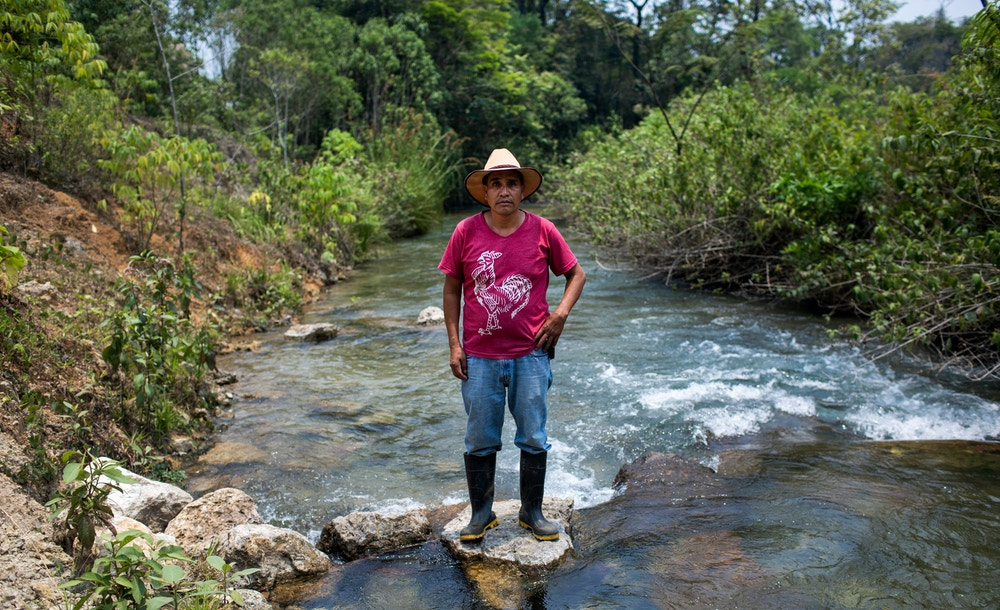Lucas Jorge Garcia, president of the local community development committee, and member of the Ixquisis Peaceful Resistance against the San Mateo Hydroelectric Project, poses for a photo along the Negro River. Ixquisis, San Mateo Ixtatan, Huehuetenango, Guatemala. April 26, 2019.