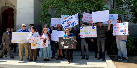Protesters against AB 44 gather outside the California State Capitol Building in Sacramento on July 9, 2019, after a Senate Judiciary Committee hearing on the bill.