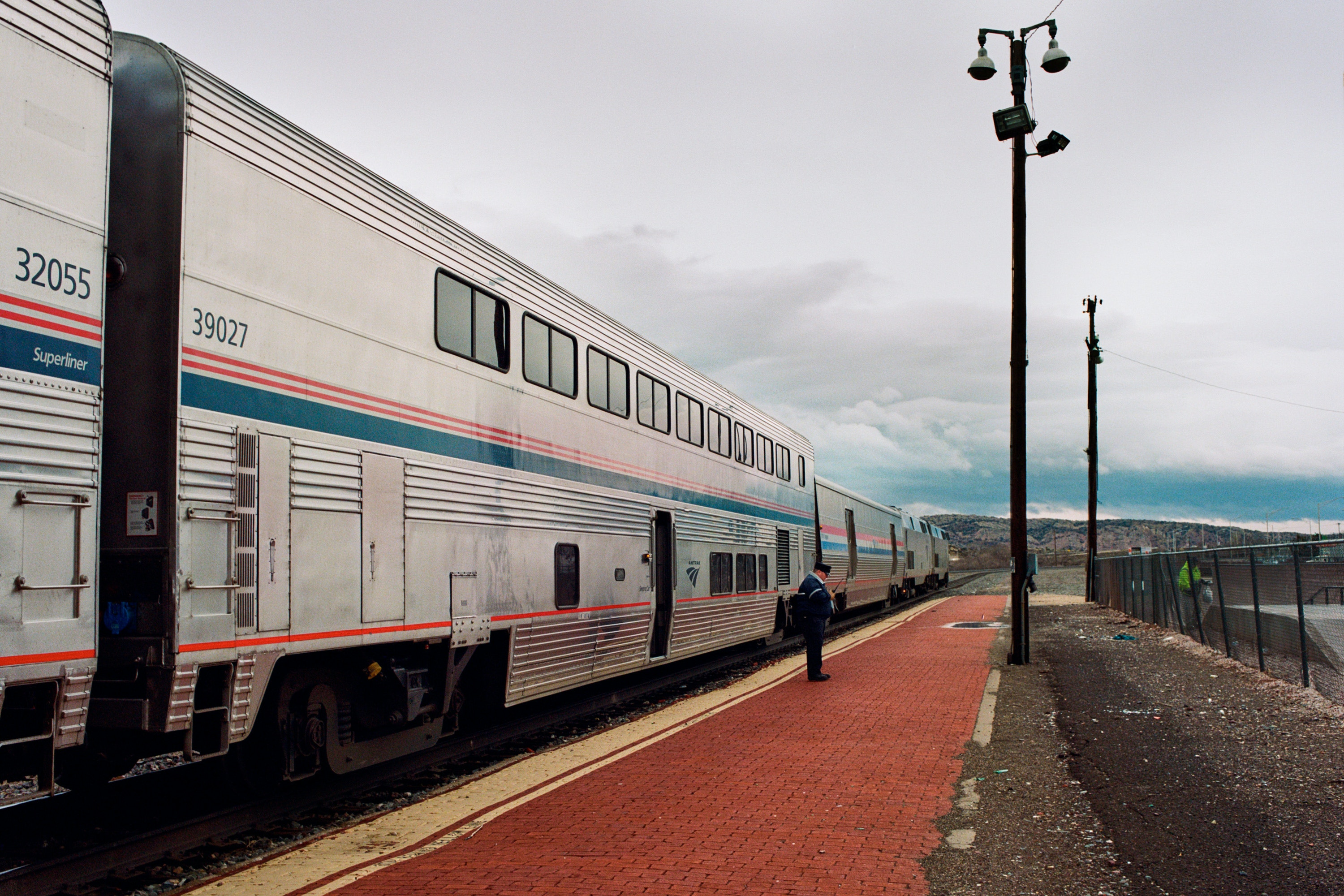 Amtrak Southwest Chief stops to pick up passengers. Those already on board have a short time to disembark fior a cigerette or some fresh air.