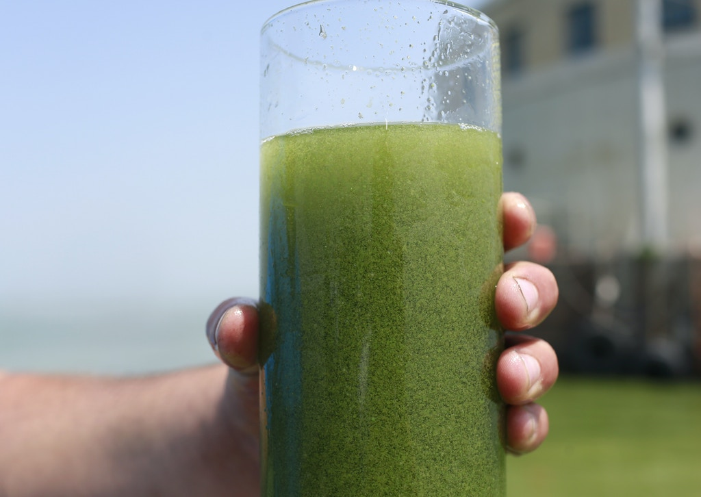 "FILE - In this Aug. 3, 2014 file photo, a sample glass of Lake Erie water is photographed near the City of Toledo water intake crib on Lake Erie, off the shore of Curtice, Ohio. Scientists are predicting a ""significant"" algae bloom will form this summer on western Lake Erie, a continuing health hazard in a region where algae toxins forced a temporary tap water shutdown in 2014. (AP Photo/Haraz N. Ghanbari, File)"