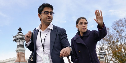 Rep.-elect Alexandria Ocasio-Cortez, D-NY., right, and her chief of staff Saikat Chakrabarti, left, walk back together after joining other members of the freshman class of Congress for a group photo on Capitol Hill in Washington, Wednesday, Nov. 14, 2018. (AP Photo/Pablo Martinez Monsivais)