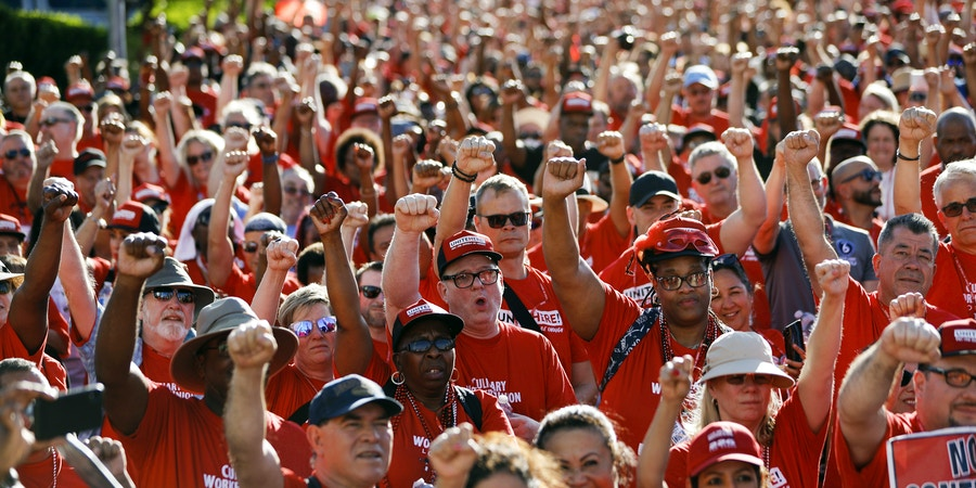 Union workers protest in front of the Palms casino-resort, Wednesday, June 26, 2019, in Las Vegas. Members of a powerful Las Vegas casino workers union and other hospitality workers picketed outside the Palms, which has refused to bargain with the union. (AP Photo/John Locher)