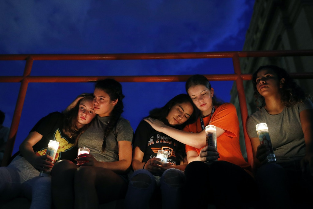 From left, Melody Stout, Hannah Payan, Aaliyah Alba, Sherie Gramlich and Laura Barrios comfort each other during a vigil for victims of the shooting Saturday, Aug. 3, 2019, in El Paso, Texas. A young gunman opened fire in an El Paso, Texas, shopping area during the busy back-to-school season, leaving multiple people dead and more than two dozen injured. (AP Photo/John Locher)