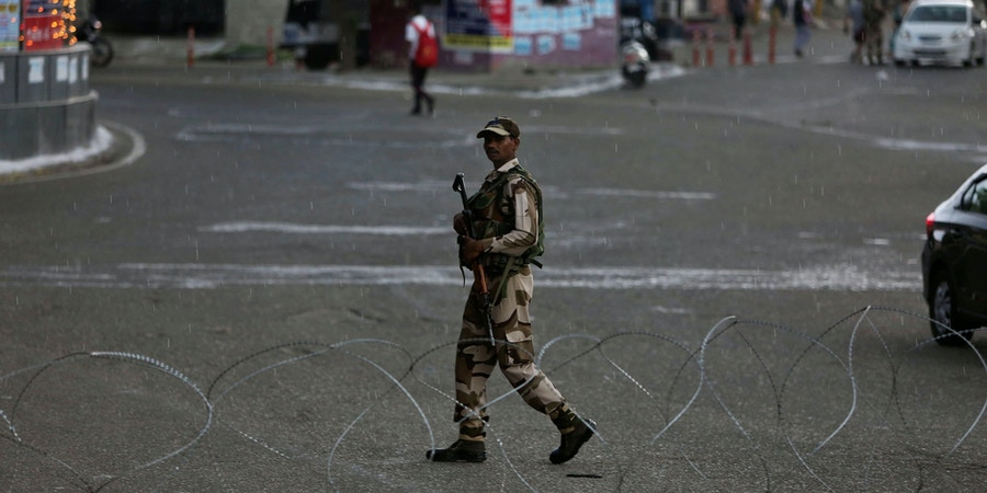 An Indian paramilitary soldier guards during security lockdown in Jammu, India, Monday, Aug. 5, 2019. India's government revoked disputed Kashmir's special status by presidential order Monday as thousands of newly deployed troops descended and some internet and phone services were suspended in the restive Himalayan region where most people oppose Indian rule. (AP Photo/Channi Anand)