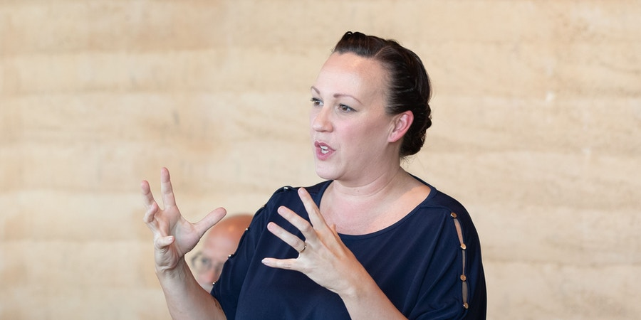 MJ Hegar, Texas Democratic Candidate for US Representative District 31, speaks to voters at an MJ Out and About in Georgetown