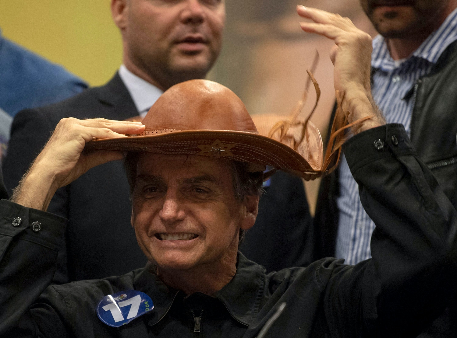 Brazil's right-wing presidential candidate for the Social Liberal Party (PSL) Jair Bolsonaro gestures during a press conference in Rio de Janeiro, Brazil on October 11, 2018. - The far-right frontrunner to be Brazil's next president, Jair Bolsonaro, stumbled Wednesday by spooking previously supportive investors, while a spate of violent incidents pointed to deep polarization caused by the election race. (Photo by Mauro Pimentel / AFP)        (Photo credit should read MAURO PIMENTEL/AFP/Getty Images)