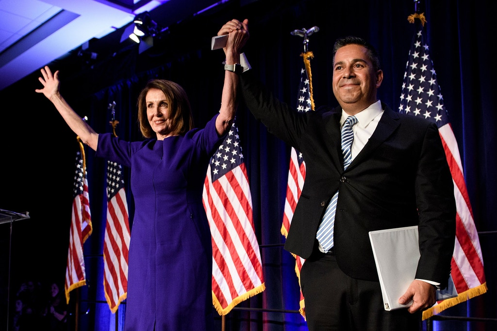 TOPSHOT - House Minority Leader Nancy Pelosi (D-CA) and Representative Ben Ray Lujan (D-MN), DCCC Chairman, celebrate a projected Democratic Party takeover of the House of Representatives during a midterm election night party hosted by the Democratic Congressional Campaign Committee on November 7, 2018 in Washington, DC. (Photo by Brendan Smialowski / AFP) / ALTERNATIVE CROP        (Photo credit should read BRENDAN SMIALOWSKI/AFP/Getty Images)