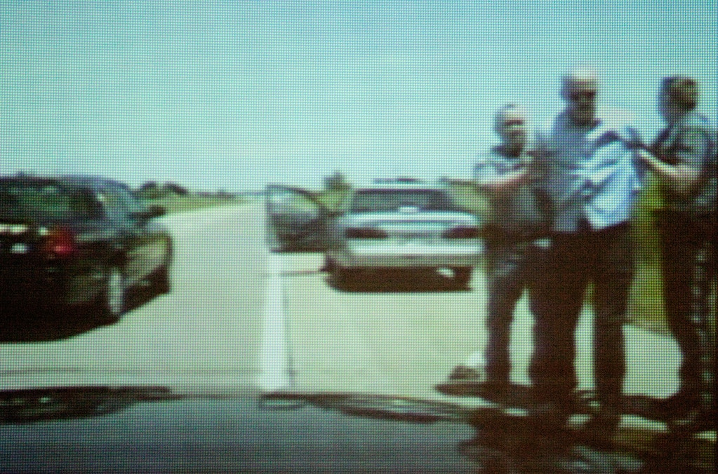 Video taken from a Johnson County Sheriff patrol car camera aired during the trial on January 26, 2010 in Wichita, Kansas, shows Scott Roeder being arrested on May 31, 2009 along Interstate 35.  (Photo by Mike Hutmacher/Wichita Eagle/MCT via Getty Images)