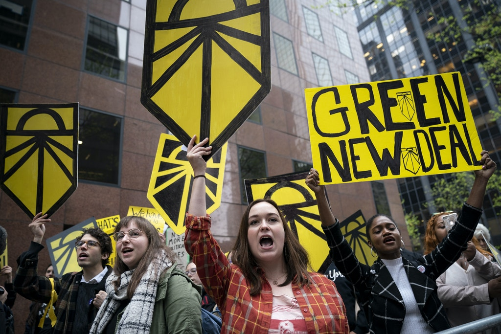 NEW YORK, NY - APRIL 30:  Activists rally in support of proposed 'Green New Deal' legislation outside of Senate Minority Leader Chuck Schumer's (D-NY) New York City office, April 30, 2019 in New York City. The activists called on Minority Leader Schumer (D-NY) to support the 'Green New Deal' legislation in Congress. (Photo by Drew Angerer/Getty Images)