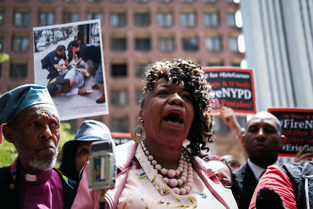 "NEW YORK, NEW YORK - MAY 21: Gwen Carr, mother of Eric Garner, joins others during a news conference outside of Police Headquarters in Manhattan to protest during the police disciplinary hearing for Officer Daniel Pantaleo, who was accused of recklessly using a chokehold that led to Eric Garner's death during an arrest in July 2014 on May 21, 2019 in New York City. Last week text messages between police officers revealed a response from Police Lt. Christopher Bannon stating that Garner's death was ""Not a big deal.""  (Photo by Spencer Platt/Getty Images)"