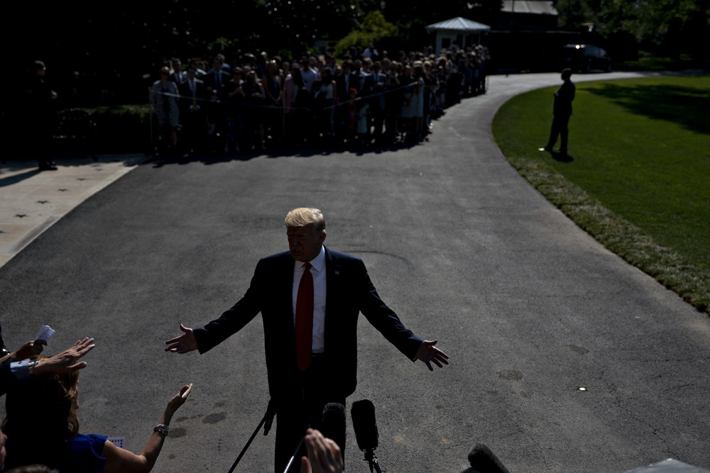 https://theintercept.imgix.net/wp-uploads/sites/1/2019/08/GettyImages-1160473348-Trump-in-shadow-1565806919.jpg?auto=compress%2Cformat&q=90&w=1000&h=667