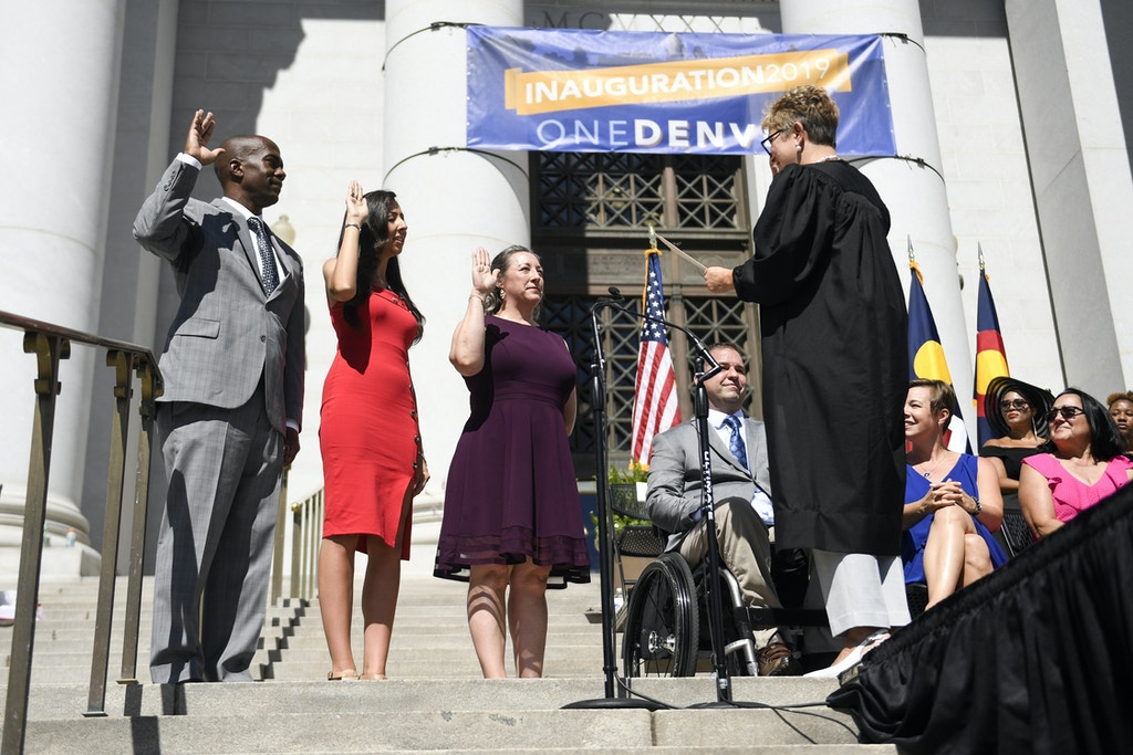 DENVER, CO - JULY 15: From left to right Christopher Herndon, Candi Lee CdeBaca and Stacie Gilmore are sworn into office by Judge Theresa Spahn during an inauguration ceremony for Denver's newly elected and re-elected officials on Monday, July 15, 2019. (Photo by AAron Ontiveroz/MediaNews Group/The Denver Post via Getty Images)