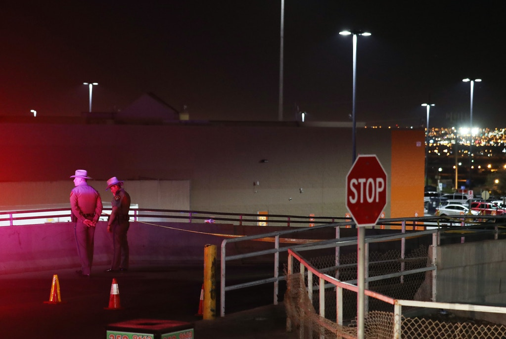 EL PASO, TEXAS - AUGUST 03:  Police keep watch outside Walmart near the scene of a mass shooting which left at least 20 people dead on August 3, 2019 in El Paso, Texas. A 21-year-old male suspect was taken into custody in the city which sits along the U.S.-Mexico border. At least 26 people were wounded.