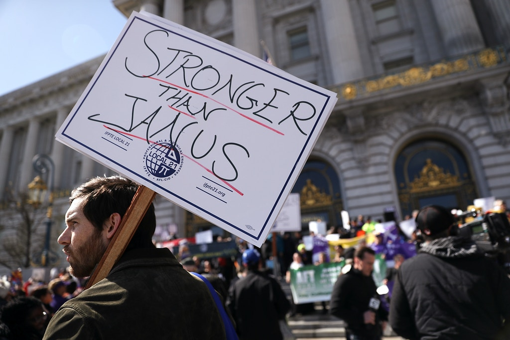 SAN FRANCISCO, CA - FEBRUARY 26:  Union members hold signs during a rally outside of San Francisco City Hall on February 26, 2018 in San Francisco, California.  Hundreds of union members held a rally outside of San Francisco City Hall as the US Supreme Court begins to hear oral arguments in the Janus V. AFSCME case that union memebers and supporters claim would limit their right to union representation by allowing members to not pay dues but still receive representation.  (Photo by Justin Sullivan/Getty Images)