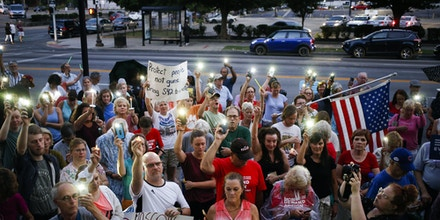 LOUISVILLE, KY - AUGUST 06: Activists participate in a moment of silence while demonstrating outside the office of U.S. Senate Majority Leader Mitch McConnell (R-KY) on August 6, 2019 in Louisville, Kentucky. Protestors from Kentucky March For Our Lives held a candlelight vigil and called on McConnell to pass legislation expanding background checks for firearms purchases in the wake of shootings in El Paso, Texas and Dayton, Ohio. (Photo by Luke Sharrett/Getty Images)