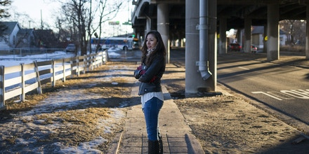 Candi CdeBaca, a resident opposing the expansion of Interstate 70, under the freeway in Denver, Jan. 10, 2017. With Denver booming, the state wants to shore up road infrastructure, but it means a repeat of hardship for the communities living near the highway.