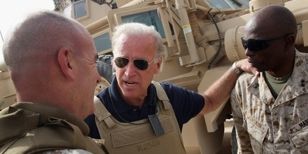 RAMADI, IRAQ - SEPTEMBER 06:  Democratic senator and Presidential candidate Joe Biden (D-DE) speaks with U.S. Marine generals before a development meeting between Iraqi and American government officials and Sunni sheikhs September 6, 2007 in Ramadi, Anbar Province, Iraq.  Biden, a vocal critic of President Bush's Iraq war policy, will be questioning U.S. ambassador Ryan Crocker and commanding General David Petraeus when they give their report to Congress next week on the state of the war in Iraq.  (Photo by John Moore/Getty Images)        *** Local Caption *** Joe Biden