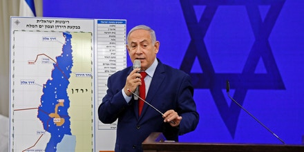 Israeli Prime Minister Benjamin Netanyahu speaks before a map of the Jordan Valley as he gives a statement in Ramat Gan, near the Israeli coastal city of Tel Aviv, on September 10, 2019. - Israeli Prime Minister Benjamin Netanyahu issued a deeply controversial pledge on September 10 to annex the Jordan Valley in the occupied West Bank if re-elected in September 17 polls. He also reiterated his intention to annex Israeli settlements throughout the West Bank if re-elected, though in coordination with US President Donald Trump, whose long-awaited peace plan is expected to be unveiled sometime after the vote. (Photo by Menahem KAHANA / AFP)        (Photo credit should read MENAHEM KAHANA/AFP/Getty Images)