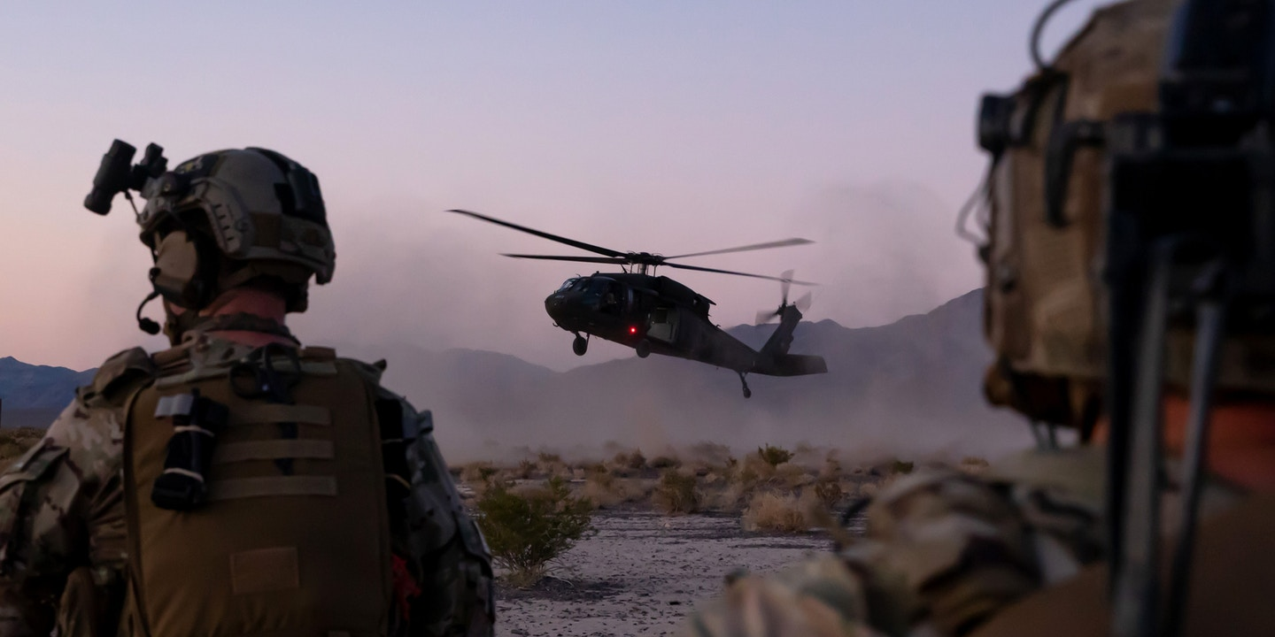 Green Berets assigned to 3rd Special Forces Group (Airborne) move to a landing UH-60 helicopter for extraction during a training event near Nellis Air Force Base, Nev. Aug. 26, 2019. U.S. Special Forces trained with U.S. Air Force Joint Terminal Attack Controllers and utilized weapons ranging from small arms to A-10 Thunderbolt ll aircraft.. (U.S. Army photo by Sgt. Steven Lewis)