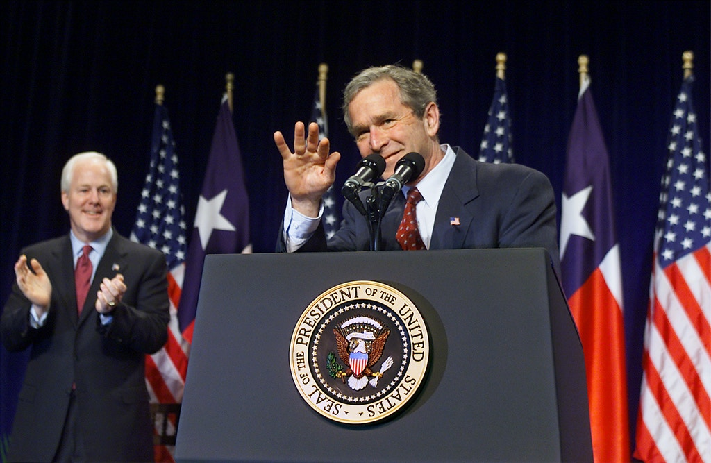 President Bush waves during a fund-raiser for Texas Attorney General John Cornyn,left, who is seeking the U.S. Senate seat being vacated by Republican Sen. Phil Gramm, in Dallas, Thursday, March 28, 2002. The stakes are high for the GOP in the elections. Democrats control the Senate by a single seat. (AP Photo/J. Scott Applewhite)