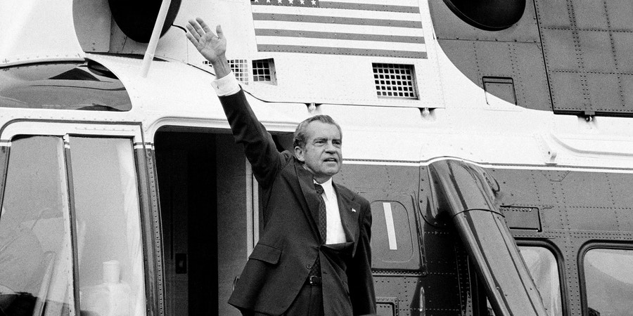 President Nixon waves goodbye from the steps of his helicopter outside the White House Aug. 9, 1974, after he gave a farewell address to members of the White House staff. The President flew to nearby Andrews Air Force Base where he boarded Air Force one for a flight to California. (AP Photo/Chick Harrity)