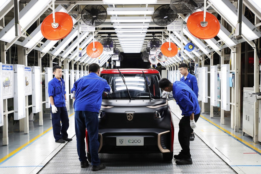 "--FILE--Chinese workers check Baojun E200 electric cars on the assembly line at an auto plant of SAIC-GM-Wuling Automobile in Qingdao city, east China's Shandong province, 28 September 2018. China's manufacturing sector expanded at a slower pace in September, official data showed Sunday (30 September 2018). The country's manufacturing purchasing managers' index came in at 50.8 in September, narrowing from 51.3 in August, according to the National Bureau of Statistics (NBS). A reading above 50 indicates expansion, while a reading below reflects contraction. ""Production continued to expand while market demand remained generally stable,"" said NBS senior statistician Zhao Qinghe. Sub-index for production edged down from 53.3 in August to 53 in September, while the sub-index for new orders dipped from 52.2 in August to 52 in September."