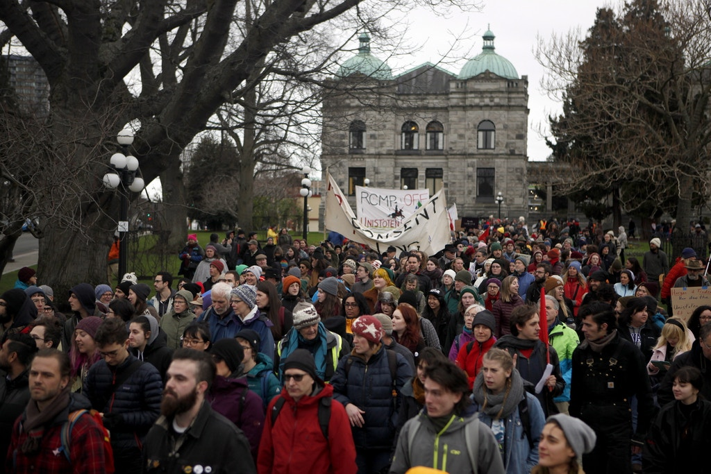 Hundreds of people gathered in support of the Unist' ot' en camp and Wet' suwet' en people during their standoff near Houston, B.C. as they protest against the LNG pipeline during a rally at Legislature in Victoria, B.C., on Tuesday, January 8, 2019. (Chad Hipolito/The Canadian Press via AP)
