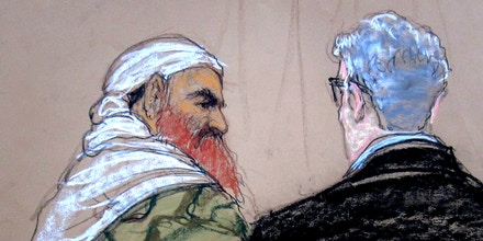 In this pool photo of a Pentagon-approved sketch by court artist Janet Hamlin, defendant Khalid Sheikh Mohammed, left, speaks with lead defense lawyer David Nevin during a pretrial hearing at the Guantanamo Bay U.S. Naval Base in Cuba, Monday, April 14, 2014. A lawyer for one of five defendants in the Sept. 11 war crimes tribunal said Monday that FBI agents questioned a member of his defense team, apparently in an investigation related to the handling of evidence, a revelation that brought an abrupt halt to proceedings. (AP Photo/Janet Hamlin, Pool)