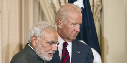 Secretary of State John Kerry, left, and Vice President Joe Biden, right, escort Indian Prime Minister Narendra Modi offstage during a luncheon at the State Department in Washington, Tuesday, Sept. 30, 2014, in the prime minister's honor. Earlier, the prime minister met with President Barack Obama at the White House and toured the Martin Luther King Memorial in Washington with President Obama.  (AP Photo/Cliff Owen)