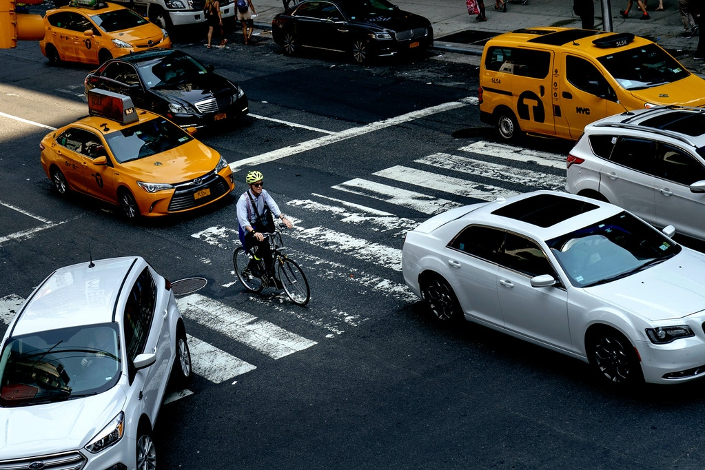 NEW YORK, NY - JULY 30: A cyclist rides through an intersection in Times Square on July 30, 2019 in New York City. As the nation's largest city tries to balance an increasing number of bicyclists along its streets, the numbers of bike riders killed and injured continues to rise. Another cyclist was killed in Brooklyn on Monday, bringing the total to 18 cyclist fatalities on New York City streets so far in 2019. New York City Mayor Bill de Blasio has vowed to increase bike safety, announcing a nearly $60 million plan to enhance bike safety and add protected bike lanes throughout the city. (Photo by Drew Angerer/Getty Images)