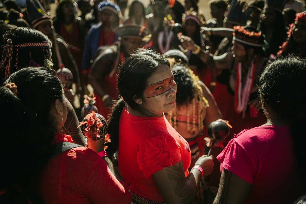 13 August 2019, Brazil, Brasilia: Indigenous women are taking part in a protest against right-wing President Bolsonaro's environmental policies and the loss of their traditional settlements. Bolsonaro wants to make greater economic use of the Amazon region in particular and allow further deforestation. Photo: Tuane Fernandes/dpa (Photo by Tuane Fernandes/picture alliance via Getty Images)