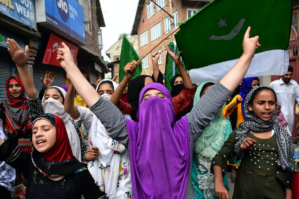 Kashmiri women shout pro-freedom slogans during protests after friday prayers in Srinagar, Indian Adminstered Kashmir on 20 September 2019. Restrictions continue in Kashmir Valley on 47th day after Indian Government scraps Article 370 on August 05, 2019. However, Indian Forces claim that the restrictions have been relaxed in many parts of Valley. (Photo by Muzamil Mattoo/NurPhoto via Getty Images)