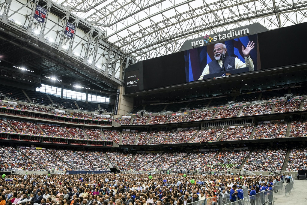 Narendra Modi, India's prime minister, is seen on the large screen as he speaks during the Howdy Modi Community Summit in Houston, Texas, U.S., on Sunday, Sept. 22, 2019. President Donald Trump received the endorsement of Modi as they shared a stage in Houston, walking hand in hand in a rock-star-like show to address more than 50,000 Indian Americans. Photographer: Scott Dalton/Bloomberg via Getty Images