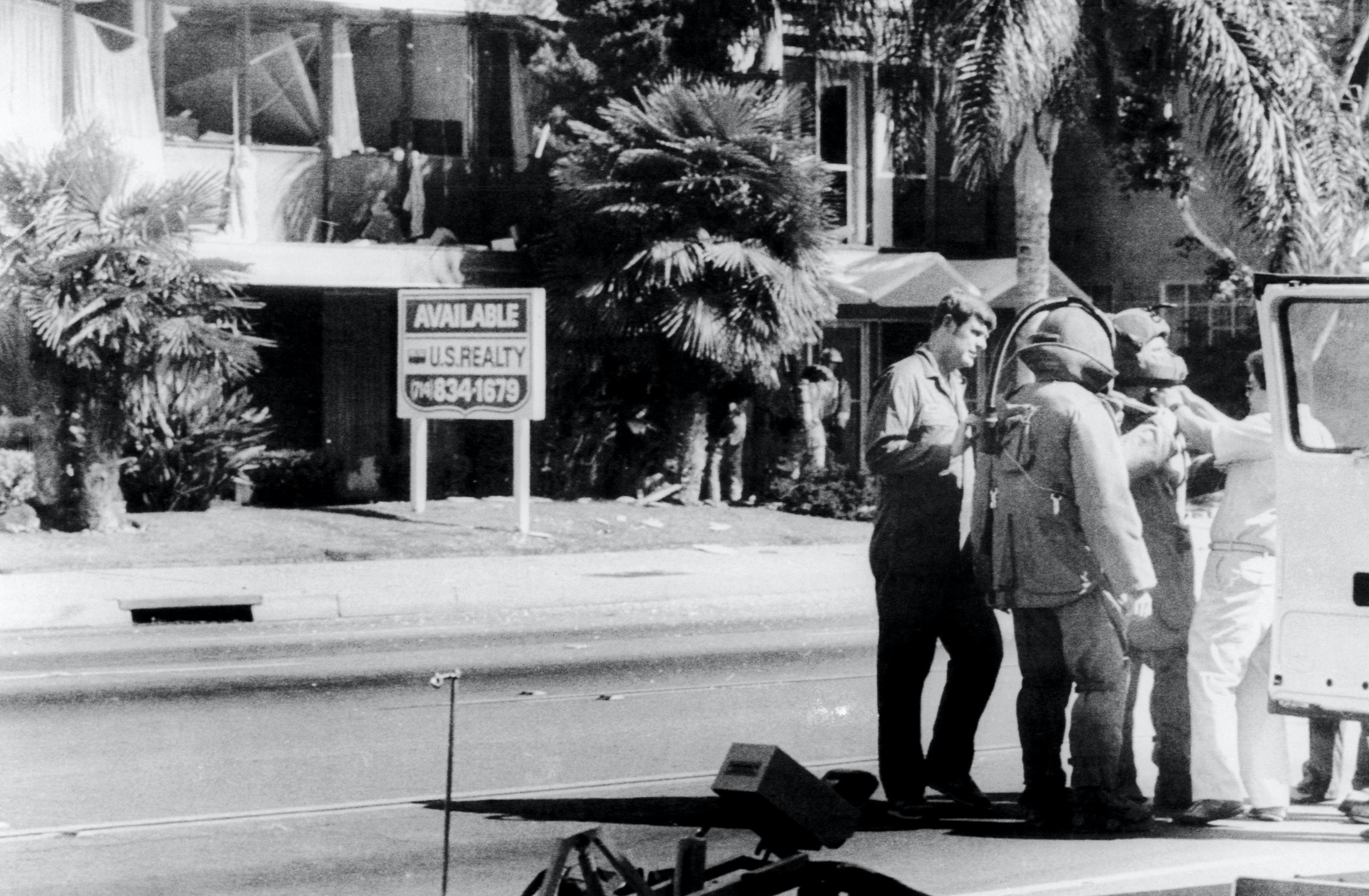 Members of the bomb squad prepare to examine the wrecked offices of the American-Arab Anti-Discrimination Committee offices in Santa Ana, Calif. The West Coast director of the ADC, Alex Odeh, was killed in the blast. On 12/5 the FBI announced it had begun an investigation of the recent attacks on ADC offices.
