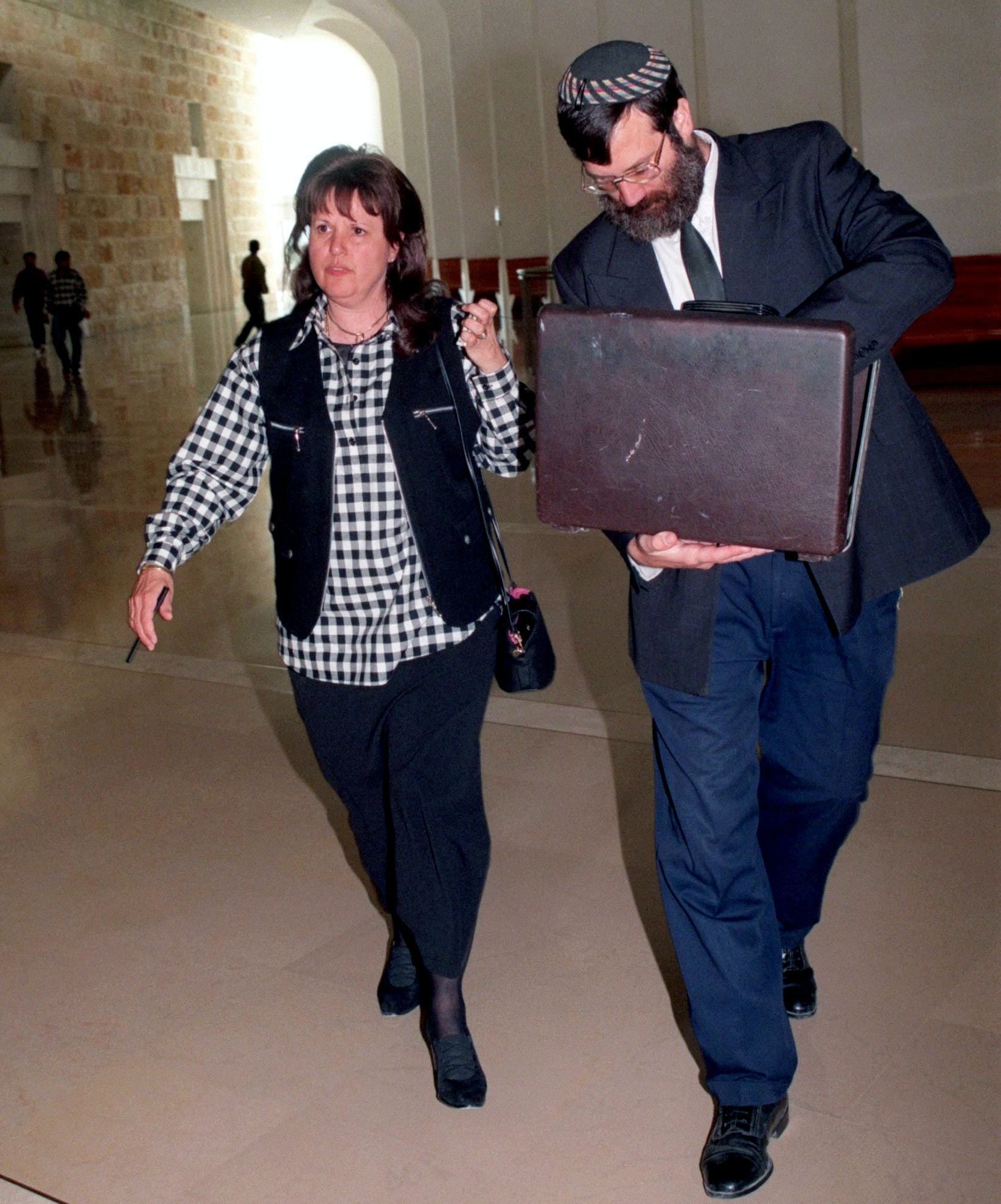 Esther Pollard, wife of convicted spy Jonathan Pollard, walks with her lawyer Baruch Ben-Yosef in the Supreme Court November 16. Jonathan Pollard petitioned the high court to block the release of hundreds of Palestinian prisoners being held in Israeli jails until he is freed. The petition said that U.S. President Bill Clinton promised during lat month's Wye Middle East peace summit to free Pollard in exchange for Israel's release of Palestinian prisoners. JWH/ME - RP1DRIFSOHAB